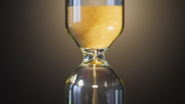 Thumbnail for Hourglass. Super  View of Sand Flowing Through an Hourglass
