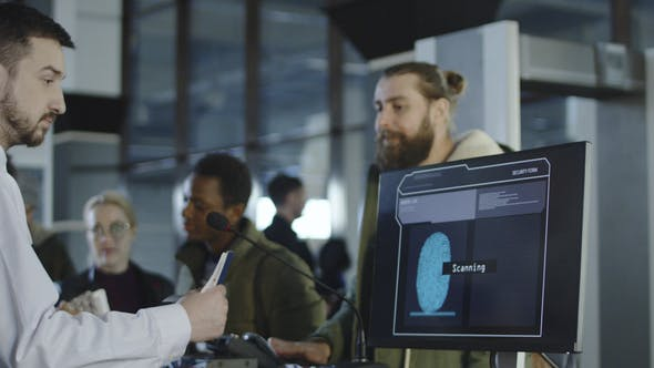 Airport Security Processing a Thumb Print