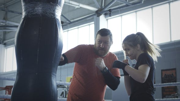 Thumbnail for Coach Training Girl in Boxing