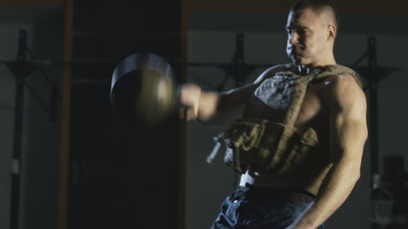 Man in Weight Vest Training with Weight Vest