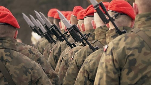 Soldiers in Red Berets with Guns Stand with Their Backs To the Camera. Presentation of Medals
