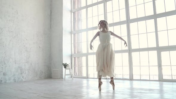Thumbnail for Ballet Dancer Dancing Classical Ballet. Young Ballerina in the Bright Light Dress.