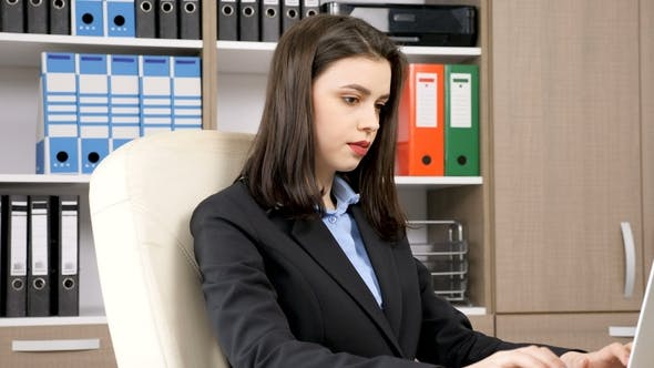 Thumbnail for Young Beautiful Businesswoman Typing on Laptop