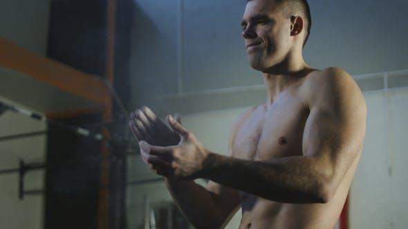 Thumbnail for Sportsman Applying Chalk Powder Before Exercise