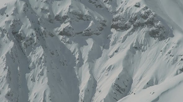 Cover Image for Heliskiing Helicopter Flies Against the Background of the Snow-capped Mountains