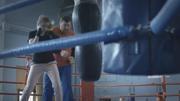 Thumbnail for Woman Boxing with Trainer on Ring