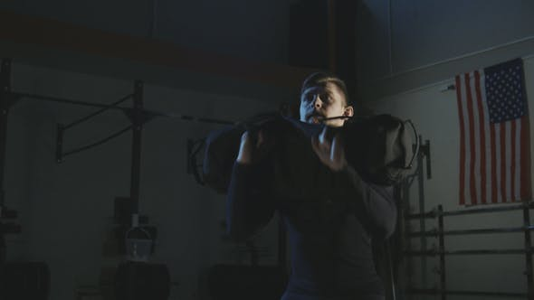 Thumbnail for Man Training with Sandbag in Gym