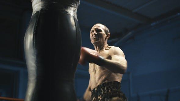 Thumbnail for Muscular Man Punching Bag on Ring