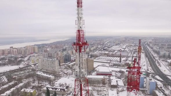 Thumbnail for Aerial Camera Is Flying Along Site with Workers on Hight on Tv Tower