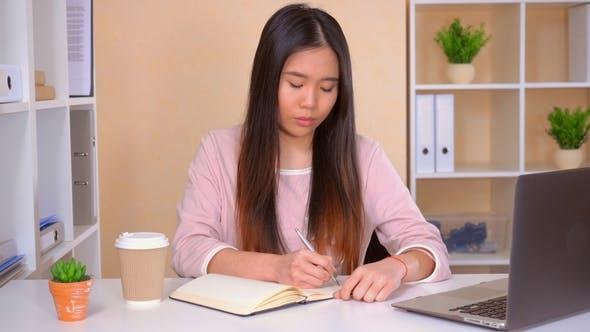 Businesswoman Planning Her Workday