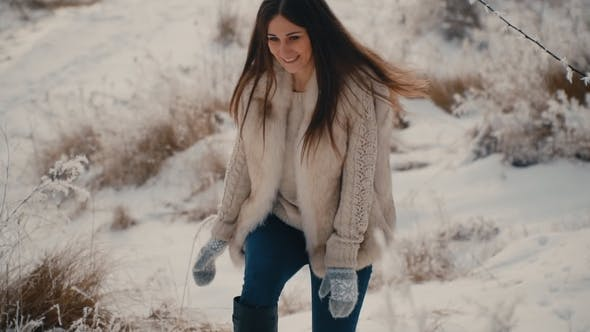 Thumbnail for Beautiful Girl Walking on Snowy Road