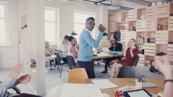 Thumbnail for Happy Black Man Doing Funny Victory Dance Celebrating Achievement. Multiethnic Colleagues Clapping