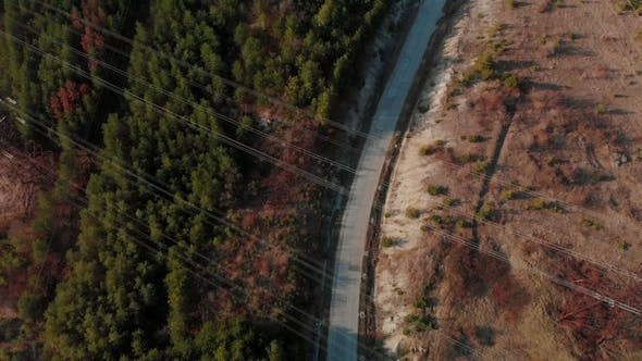 Thumbnail for Aerial Top View of Country Road. Cinematic Toned. Drone Shot Flying Over Electrical Wires and