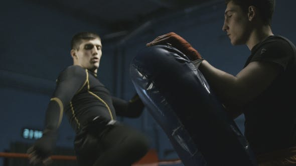 Thumbnail for Man Training Box with Instructor in Gym