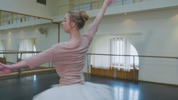Thumbnail for Ballerina in White Ballet Tutu Dress Practicing in Dance Studio or Gym. Woman Jumping in Class Room