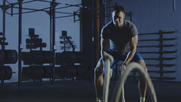 Thumbnail for Athletic Man Working Out with Ropes in Gym
