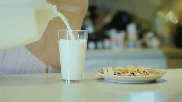 Thumbnail for Unrecognizable Woman Pours Milk Into a Glass and Drinks. A Good Start To a New Day, Healthy Eating