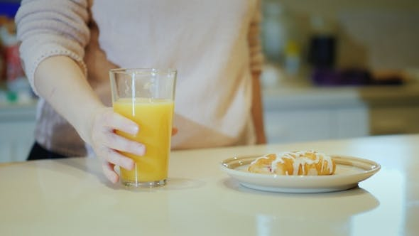 Thumbnail for Woman Drinking Orange Juice From Glass