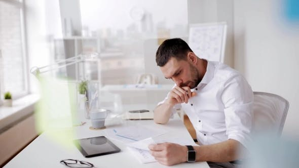 Thumbnail for Businessman with Tablet Pc and Papers at Office 9
