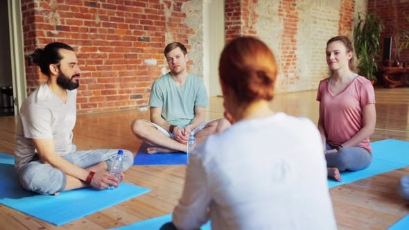 Thumbnail for Group of People Resting on Yoga Mats in Gym 33