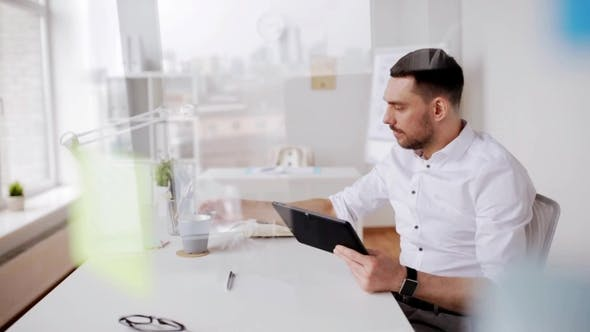 Thumbnail for Businessman with Tablet Pc and Coffee at Office 4