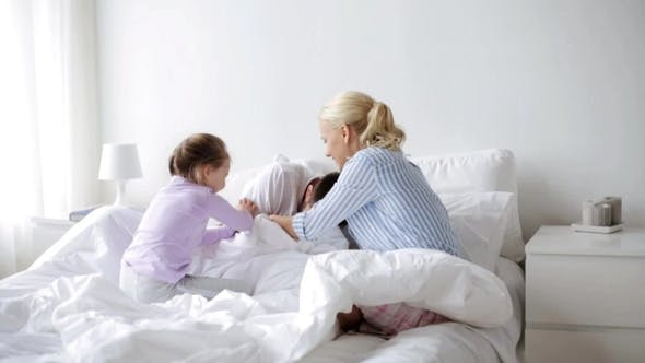 Thumbnail for Happy Family Having Fun in Bed at Home 25