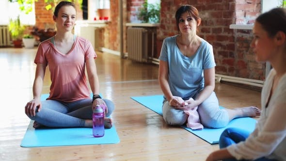 Thumbnail for Group of Women Resting on Yoga Mats in Gym 4