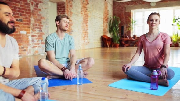 Thumbnail for Group of People Resting on Yoga Mats in Gym 31