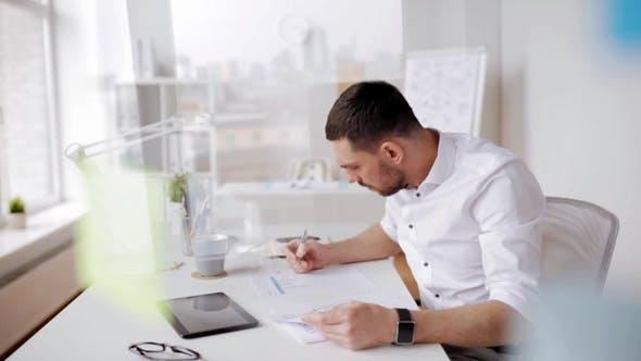 Thumbnail for Businessman with Tablet Pc and Papers at Office 7