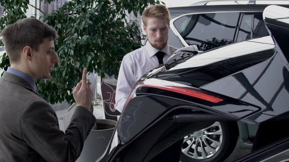 Thumbnail for Male Manager Opening Trunk of Car To Show It To the Customer in Autocenter