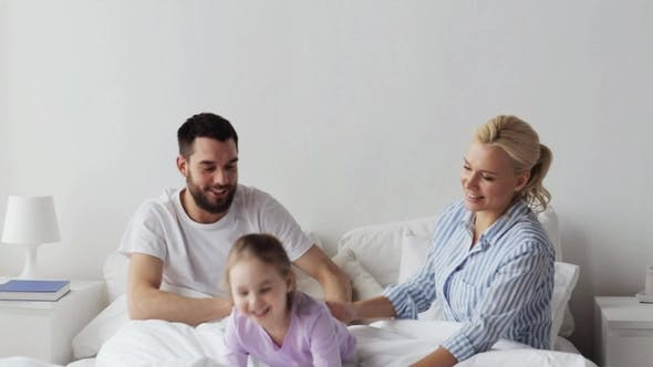 Thumbnail for Happy Family Having Fun in Bed at Home 8