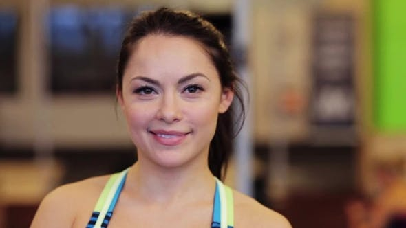 Thumbnail for Portrait of Happy Smiling Young Woman at Gym