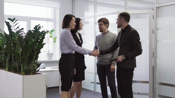 Thumbnail for Team of Successful and Happy Business People Shaking Hands After Negotiations