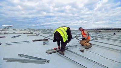 Installation of solar panels. Solar panel technician installing solar panels