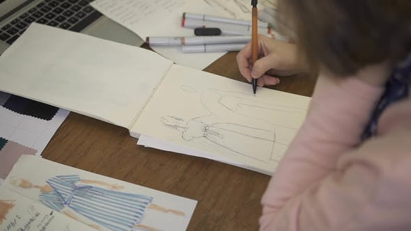 Thumbnail for On Paper Pencil Female Fashion Designer Makes Sketches of Clothes.