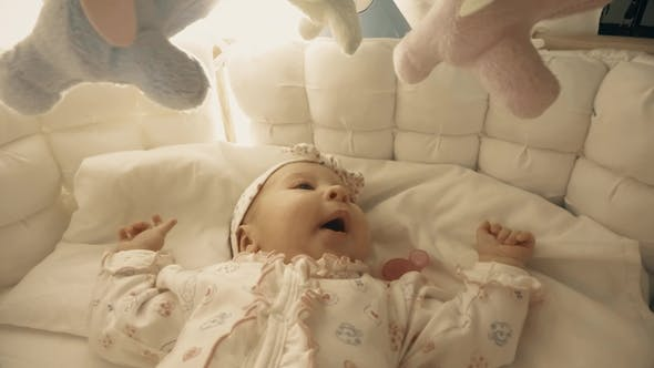 Thumbnail for Baby Girl About To Sleep in Her Cot