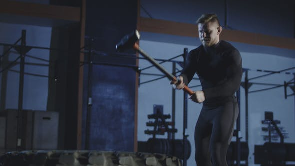 Thumbnail for Tired Man Working Out with Sledgehammer