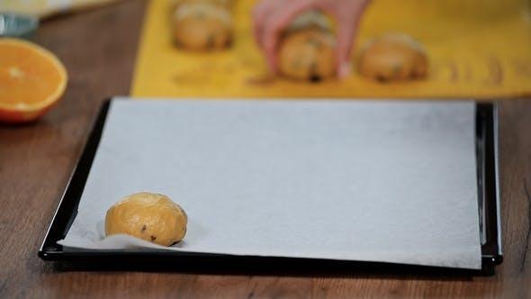 Thumbnail for Buns on a Baking Sheet. Putting the Buns on a Baking Sheet