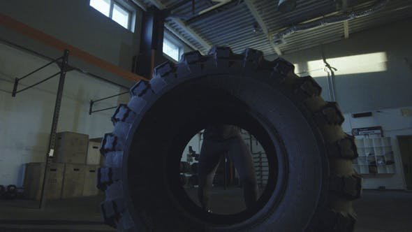 Thumbnail for Man Pulling Large Tyre at Crossfit Training
