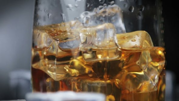 Cover Image for Whiskey in a Glass of Ice on a Black Background