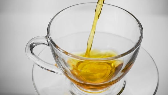Thumbnail for Green Tea. Pouring Tea Into a Glass Cup