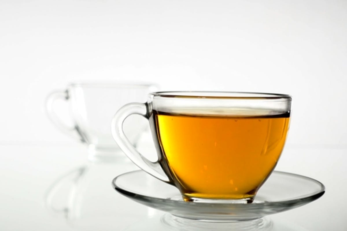 Tea Pouring. Tea Being Poured Into Glass Transparent Tea Cup. Tea Time.  Transparent Glass Teapot and by Puzurin on Envato Elements