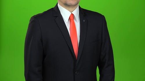 Man Untying His Red Tie