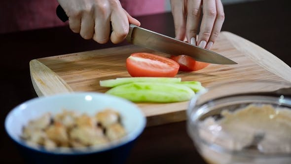 Thumbnail for Female Hands Slicing Red Tomato, Dolly Shot