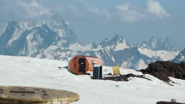 Thumbnail for Orange Metal Barrel Tourist Shelter at Hight Mountain Picturesque Landscape