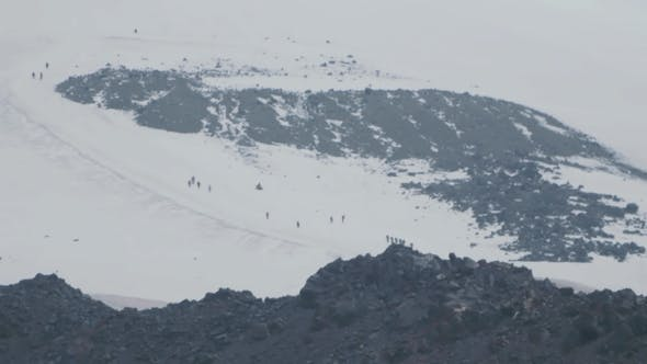Thumbnail for People Climbers Tourists Walking on Hight Snowy Mountain Slope