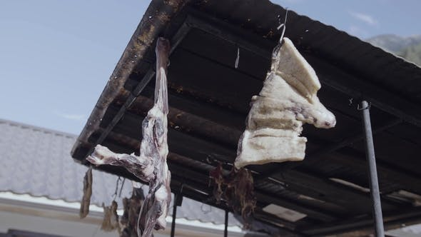 Thumbnail for Jerky Meat Hanging Under Metal Tile Roof at Mountain Village