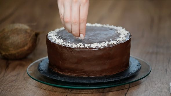 Thumbnail for Decorating Chocolate Cake with Coconut Flakes