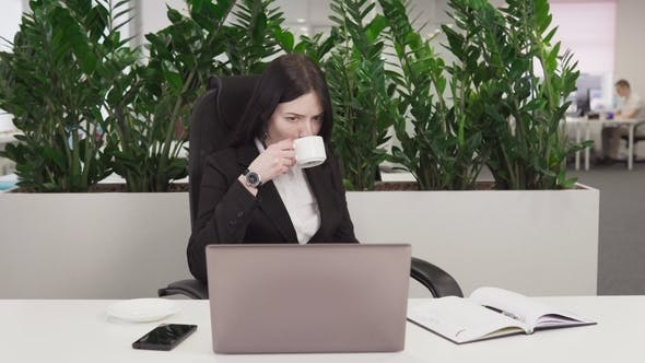 Cover Image for Business Woman Sees Bad News on Laptop Screen, Upset and Swears