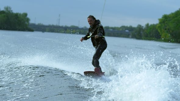 Thumbnail for Young Man on Wakeboard Dissecting River Waves